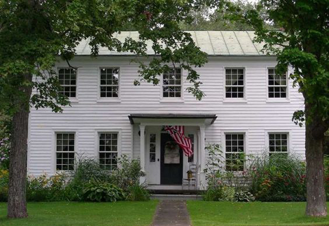 White Colonial Home With Black Door
